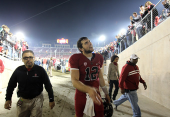 STANFORD, CA - NOVEMBER 26:  Andrew Luck #12 of the Stanford Cardinal smiles to the crowd as he leaves the field after beating the Notre Dame Fighting Irish at Stanford Stadium on November 26, 2011 in Stanford, California.  (Photo by Ezra Shaw/Getty Image