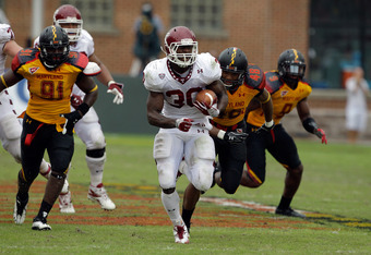 COLLEGE PARK, MD - SEPTEMBER 24:  Running back Bernard Pierce #30 of the Temple Owls outruns the Maryland Terrapins defense for a second quarter touchdown at Byrd Stadium on September 24, 2011 in College Park, Maryland.  (Photo by Rob Carr/Getty Images)