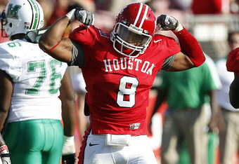 HOUSTON - OCTOBER 22:  Linebacker Sammy Brown #8 of the Houston Cougars flexes his muscles after sacking quarterback A.J. Graham #1 of the Marshall Thundering Herd at Robertson Stadium on October 22, 2011 in Houston, Texas.  (Photo by Bob Levey/Getty Imag