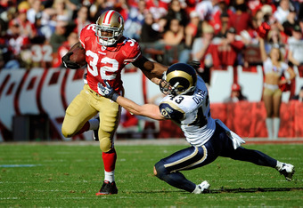 SAN FRANCISCO, CA - DECEMBER 04:  Kendall Hunter #32 of the San Francisco 49ers attempts to break the tackle of Craig Dahl #43 of the St Louis Rams at Candlestick Park on December 4, 2011 in San Francisco, California.  (Photo by Thearon W. Henderson/Getty
