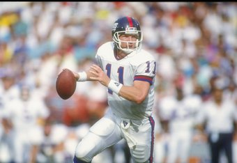 11 Nov 1990:  Quarterback Phil Simms of the New York Giants looks to pass the ball during a game against the Los Angeles Rams at Anaheim Stadium in Anaheim, California.  The Giants won the game, 31-7. Mandatory Credit: Mike Powell  /Allsport