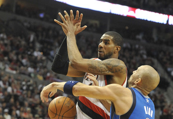 PORTLAND, OR - APRIL 28: LaMarcus Aldridge #12 of the Portland Trail Blazers is fouled by Jason Kidd #2 of the Dallas Mavericks during the fourth quarter of Game Six of the Western Conference Quartefinals in the 2011 NBA Playsoffs on April 28, 2011 at the