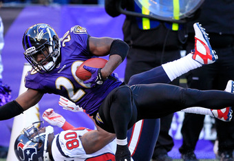 BALTIMORE, MD - JANUARY 15:  Ed Reed #20 of the Baltimore Ravens intercepts a pass intended for  Andre Johnson #80 of the Houston Texans during the fourth quarter of the AFC Divisional playoff game at M&T Bank Stadium on January 15, 2012 in Baltimore, Mar