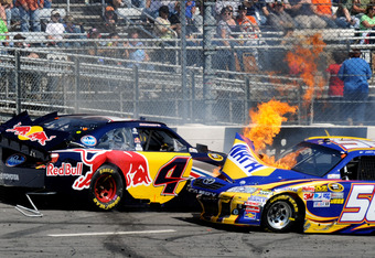 MARTINSVILLE, VA - APRIL 03:  The #56 NAPA Auto Parts Toyota, driven by Martin Truex Jr., catches fire after an incident with Kasey Kahne, driver of the #4 Red Bull Toyota, during the NASCAR Sprint Cup Series Goody's Fast Relief 500 at Martinsville Speedw