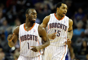 CHARLOTTE, NC - JANUARY 14:  Teammates Kemba Walker and Gerald Henderson #15 of the Charlotte Bobcats celebrate against the Golden State Warriors during their game at Time Warner Cable Arena on January 14, 2012 in Charlotte, North Carolina.  NOTE TO USER:
