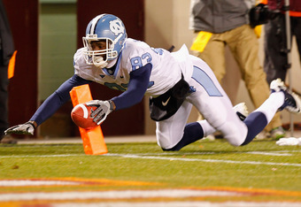 BLACKSBURG, VA - NOVEMBER 17: Dwight Jones #83 of the North Carolina Tar Heels dives with the ball against the Virginia Tech Hokies at Lane Stadium on November 17, 2011 in Blacksburg, Virginia. (Photo by Geoff Burke/Getty Images)  (Photo by Geoff Burke/Ge