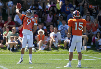 ENGLEWOOD, CO - AUGUST 05:  Quarterbacks Brady Quinn #9 and Tim Tebow #15 of the Denver Bronocs toss the ball during practice at training camp at Dove Valley on August 5, 2010 in Englewood, Colorado.  (Photo by Doug Pensinger/Getty Images)