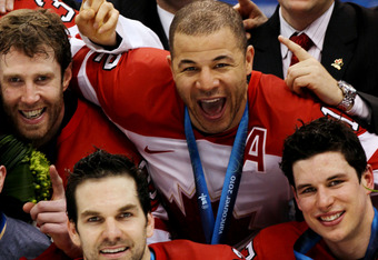 VANCOUVER, BC - FEBRUARY 28:  Jarome Iginla #12 of Canada celebrates with his team after winning the gold medal after the ice hockey men's gold medal game between USA and Canada on day 17 of the Vancouver 2010 Winter Olympics at Canada Hockey Place on Feb