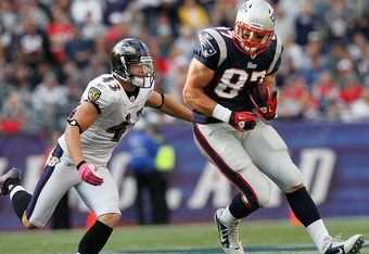 FOXBORO, MA - OCTOBER 17:  Rob Gronkowski #87 of the New England Patriots gains yards as he is chased by Haruki Nakamura #43 of the Baltimore Ravens at Gillette Stadium on October 17, 2010 in Foxboro, Massachusetts. (Photo by Jim Rogash/Getty Images)