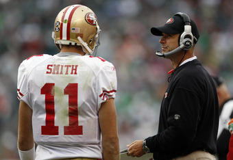 PHILADELPHIA, PA - OCTOBER 02: Head coach Jim Harbaugh of the San Francisco 49ers talks with quarterback Alex Smith #11during a timeout against the Philadelphia Eagles during an NFL football game at Lincoln Financial Field on October 2, 2011 in Philadelph