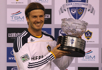 MELBOURNE, AUSTRALIA - DECEMBER 06:  David Beckham of the Galaxy poses with the man of the match trophy during the friendly match between the Melbourne Victory and LA Galaxy at Etihad Stadium on December 6, 2011 in Melbourne, Australia.  (Photo by Quinn R