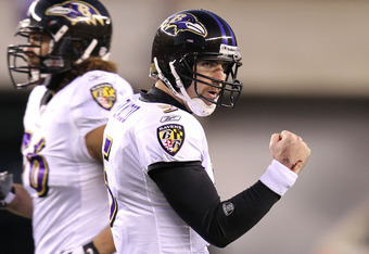 CINCINNATI, OH - JANUARY 01:  Joe Flacco #5 of the Baltimore Ravens celebrates after throwing a touchdown pass during the NFL game against  the Cincinnati Bengals at Paul Brown Stadium on January 1, 2012 in Cincinnati, Ohio.  (Photo by Andy Lyons/Getty Im