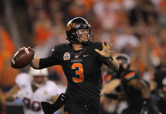 GLENDALE, AZ - JANUARY 02:  Brandon Weeden #3 of the Oklahoma State Cowboys throws a pass against the Stanford Cardinal  during the Tostitos Fiesta Bowl on January 2, 2012 at University of Phoenix Stadium in Glendale, Arizona. Oklahoma State won 41-38 in
