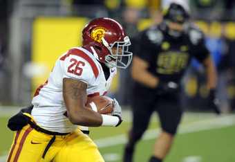 EUGENE, OR - NOVEMBER 19: Running back Marc Tyler #26 of the USC Trojans runs with the ball in the first half of the game against the Oregon Ducks at Autzen Stadium on November 19, 2011 in Eugene, Oregon. (Photo by Steve Dykes/Getty Images)