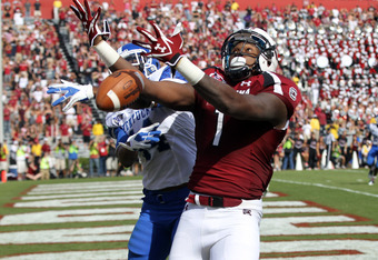 COLUMBIA, SC - OCTOBER 08:  Anthony Mosley #14 of the Kentucky Wildcats breaks up a pass to Alshon Jeffery #1 of the South Carolina Gamecocks during their game at Williams-Brice Stadium on October 8, 2011 in Columbia, South Carolina.  (Photo by Streeter L