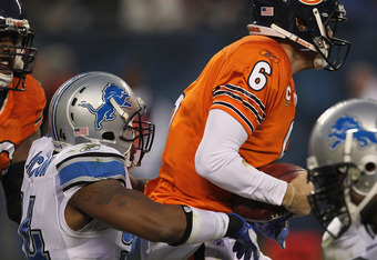 CHICAGO, IL - NOVEMBER 13: Jay Cutler #6 of the Chicago Bears is sacked by Lawrence Jackson #94 of the Detroit Lions at Soldier Field on November 13, 2011 in Chicago, Illinois. (Photo by Jonathan Daniel/Getty Images)