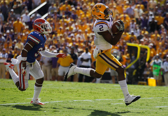 BATON ROUGE, LA - OCTOBER 08:  Rueben Randle #2 of the Louisiana State University Tigers scores a touchdown pass over Cody Riggs #31 of the Florida Gators at Tiger Stadium on October 8, 2011 in Baton Rouge, Louisiana.  (Photo by Chris Graythen/Getty Image