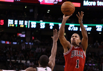 BOSTON, MA - JANUARY 13:  Derrick Rose #1 of the Chicago Bulls takes a shot as Rajon Rondo #9 of the Boston Celtics defends on January 13, 2012 at TD Garden in Boston, Massachusetts. The Chicago Bulls defeated the Boston Celtics 88-79. NOTE TO USER: User