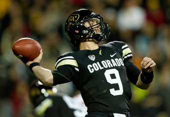 BOULDER, CO - NOVEMBER 4:  Quarterback Tyler Hansen #9 of the Colorado Buffaloes throws a 45-yard pass during the second quarter against the USC Trojans at Folsom Field on November 4, 2011 in Boulder, Colorado. (Photo by Justin Edmonds/Getty Images)