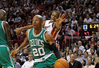 MIAMI, FL - DECEMBER 27: Ray Allen #20 of the Boston Celtics drives past James Jones #22 of the Miami Heat during a game  at American Airlines Arena on December 27, 2011 in Miami, Florida. NOTE TO USER: User expressly acknowledges and agrees that, by down