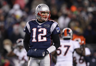 FOXBORO, MA - JANUARY 14:  Tom Brady #12 of the New England Patriots looks on against the Denver Broncos during their AFC Divisional Playoff Game at Gillette Stadium on January 14, 2012 in Foxboro, Massachusetts.  (Photo by Elsa/Getty Images)
