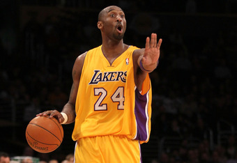 LOS ANGELES, CA - JANUARY 13:  Kobe Bryant #24 of the Los Angeles Lakers sgnals his offense as he controls the ball against against the Cleveland Cavaliers at Staples Center on January 13, 2012 in Los Angeles, California.  NOTE TO USER: User expressly ack
