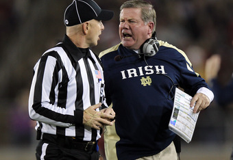STANFORD, CA - NOVEMBER 26:  Notre Dame Fighting Irish head coach Brian Kelly argues a call with side judge Glenn Crowther during their game against the Stanford Cardinal at Stanford Stadium on November 26, 2011 in Stanford, California.  (Photo by Ezra Sh