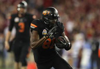 GLENDALE, AZ - JANUARY 02:  Justin Blackmon #81 of the Oklahoma State Cowboys catches a first down pass on a fourth down play against the Stanford Cardinal during the Tostitos Fiesta Bowl on January 2, 2012 at University of Phoenix Stadium in Glendale, Ar