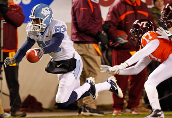 BLACKSBURG, VA - NOVEMBER 17: Dwight Jones #83 of the North Carolina Tar Heels dives with the ball in front of Kyle Fuller #17 of the Virginia Tech Hokies at Lane Stadium on November 17, 2011 in Blacksburg, Virginia. (Photo by Geoff Burke/Getty Images)