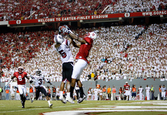 RALEIGH, NC - SEPTEMBER 3:  Stephon Gilmore #5 of the South Carolina Gamecocks knocks down the ball against Jarvis Williams #5 of the North Carolina State Wolfpack that seal a 7-3 victory for the Gamecocks during their game at Carter-Finley Stadium on Sep