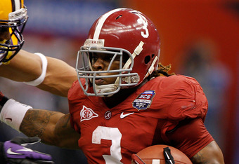 NEW ORLEANS, LA - JANUARY 09:  Trent Richardson #3 of the Alabama Crimson Tide runs with the ball against Eric Reid #1 of the Louisiana State University Tigers during the 2012 Allstate BCS National Championship Game at Mercedes-Benz Superdome on January 9