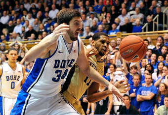 DURHAM, NC - JANUARY 19:  Ryan Kelly #34 of the Duke Blue Devils battles C.J. Harris #11 of the Wake Forest Demon Deacons for a loose ball during play at Cameron Indoor Stadium on January 19, 2012 in Durham, North Carolina.  (Photo by Grant Halverson/Gett