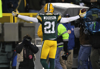 GREEN BAY, WI - DECEMBER 11: Charles Woodson #21 of the Green Bay Packers celebrates an interception against the Oakland Raiders at Lambeau Field on December 11, 2011 in Green Bay, Wisconsin. The Packers defeated the Raiders 46-16. (Photo by Jonathan Dani