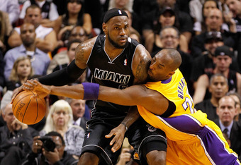 MIAMI, FL - JANUARY 19:  LeBron James #6 of the Miami Heat is guarded by Kobe Bryant #24 of the Los Angeles Lakers during a game at American Airlines Arena on January 19, 2012 in Miami, Florida. NOTE TO USER: User expressly acknowledges and agrees that, b