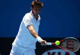 MELBOURNE, AUSTRALIA - JANUARY 19:  Nicolas Mahut of France plays a backhand in his second round match against Tatsuma Ito of Japan during day four of the 2012 Australian Open at Melbourne Park on January 19, 2012 in Melbourne, Australia.  (Photo by Clive