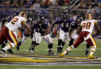 BALTIMORE, MD - AUGUST 25:  Offensive lineman Michael Oher #74 of the Baltimore Ravens and fullback Vonta Leach #44 along with Johdrick Morris #84 block members of the Washington Redskins during a preseason game  M&T Bank Stadium on August 25, 2011 in Bal