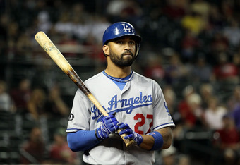 PHOENIX, AZ - SEPTEMBER 28:  Matt Kemp #27 of the Los Angeles Dodgers warms up on deck during the Major League Baseball game against the Arizona Diamondbacks at Chase Field on September 28, 2011 in Phoenix, Arizona. The Dodgers defeated the Diamondbacks 7