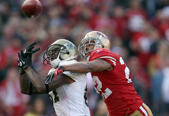 SAN FRANCISCO, CA - JANUARY 14:  Carlos Rogers #22 of the San Francisco 49ers forces an incomplete pass against Adrian Arrington #87 of the New Orleans Saints during the third quarter of the NFC Divisional playoff game at Candlestick Park on January 14, 2