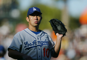 SAN FRANCISCO - JUNE 24:  Hideo Nomo #10 of the Los Angeles Dodgers waits to catch the ball during the game against the San Francisco Giants on June 24, 2004 at SBC Park in San Francisco, California. The Giants defeated the Dodgers 9-3.  (Photo by Justin