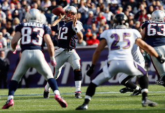 FOXBORO, MA - OCTOBER 17:  Tom Brady #12 of the New England Patriots looks for an open man during a game against the Baltimore Ravens at Gillette Stadium in the second half on October 17, 2010 in Foxboro, Massachusetts. (Photo by Jim Rogash/Getty Images)