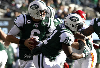 EAST RUTHERFORD, NJ - DECEMBER 11:  Mark Sanchez #6 of the New York Jets rolls out during a game against the Kansas City Chiefs at MetLife Stadium on December 11, 2011 in East Rutherford, New Jersey.  (Photo by Jeff Zelevansky/Getty Images)