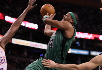 BOSTON, MA - JANUARY 16:  Paul Pierce #34 of the Boston Celtics tries to take a shot as Nazr Mohammed #8 of the Oklahoma City Thunder defends on January 16, 2012 at TD Garden in Boston, Massachusetts. NOTE TO USER: User expressly acknowledges and agrees t
