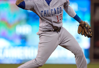 SAN DIEGO, CA - SEPTEMBER 26: Starlin Castro #13 of the Chicago Cubs throws the ball to first base for the out during the game against the San Diego Padres at Petco Park on September 26, 2011 in San Diego, California. (Photo by Kent C. Horner/Getty Images