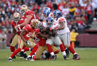 SAN FRANCISCO, CA - NOVEMBER 13:  D.J. Ware #28 of the New York Giants is tackled by NaVorro Bowman #53 of the San Francisco 49ers at Candlestick Park on November 13, 2011 in San Francisco, California.  (Photo by Ezra Shaw/Getty Images)