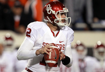 STILLWATER, OK - DECEMBER 03:  Landry Jones #12 of the Oklahoma Sooners throws against the Oklahoma State Cowboys at Boone Pickens Stadium on December 3, 2011 in Stillwater, Oklahoma.  (Photo by Ronald Martinez/Getty Images)