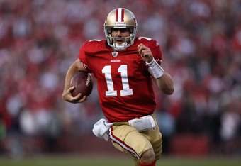 SAN FRANCISCO, CA - JANUARY 14:  Alex Smith #11 of the San Francisco 49ers runs in for a touchdown in the fourth quarter against the New Orleans Saints during the NFC Divisional playoff game at Candlestick Park on January 14, 2012 in San Francisco, Califo