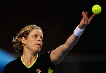 MELBOURNE, AUSTRALIA - JANUARY 20:  Kim Clijsters of Belgium serves in her third round match against Daniela Hantuchova of Slovakia during day five of the 2012 Australian Open at Melbourne Park on January 20, 2012 in Melbourne, Australia.  (Photo by Mark