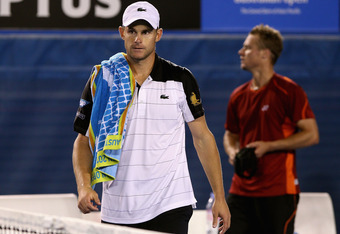 MELBOURNE, AUSTRALIA - JANUARY 19:  Andy Roddick (L) of the USA walks from the court after retiring in his second round match against Lleyton Hewitt of Australia during day four of the 2012 Australian Open at Melbourne Park on January 19, 2012 in Melbourn