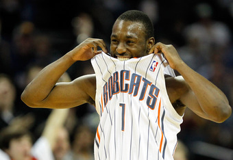 CHARLOTTE, NC - JANUARY 14:  Kemba Walker #1 of the Charlotte Bobcats celebrates after a basket against the Golden State Warriors during their game at Time Warner Cable Arena on January 14, 2012 in Charlotte, North Carolina.  NOTE TO USER: User expressly