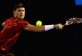 MELBOURNE, AUSTRALIA - JANUARY 21:  Lleyton Hewitt of Australia plays a backhand in his third round match against Milos Raonic of Canada during day six of the 2012 Australian Open at Melbourne Park on January 21, 2012 in Melbourne, Australia.  (Photo by R